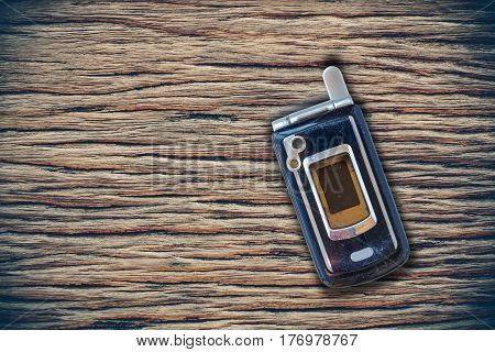 Vintage mobile phone put on wooden with blank space for texts display