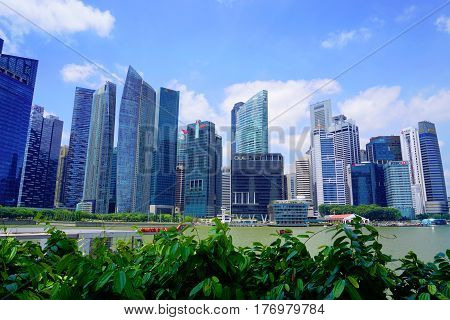 Singapore, Singapore - February 10, 2017: Singapore river near skyscrapers on sunny day in Singapore.