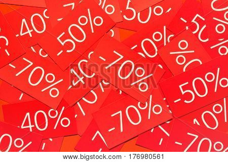 Discounts 40, 50 and 70 percents. Background with red tags with percentages