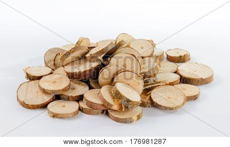 Heap of many little round pieces of sawn pine branches on white background