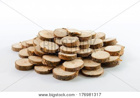 Stack of many little pieces of sawn pine branches on white background