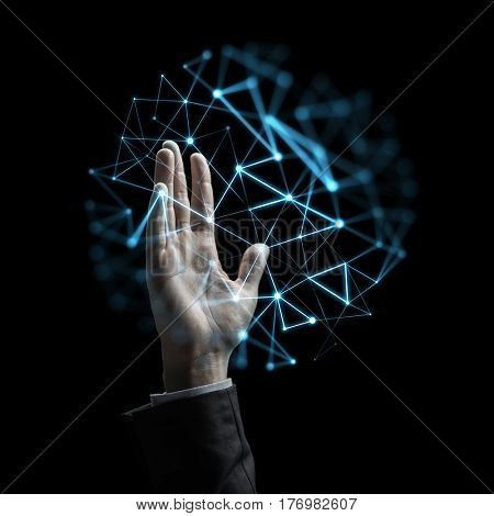 business, people, network and future technology concept - raised businessman hand with low poly projection over black background