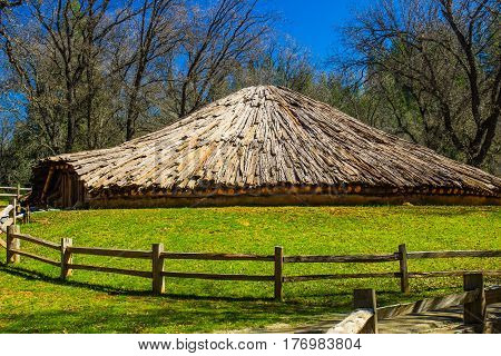 American Indian Round House With Split Rail Fence
