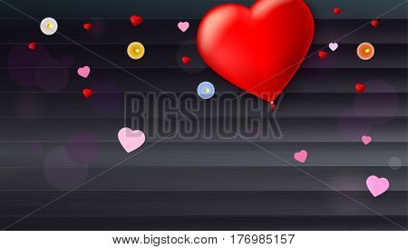 Red inflatable balloon in the shape of a heart with candles, tinsel and confetti on wooden background. Template for creative persons. Best background for holiday, vacation, festive greetings cards.