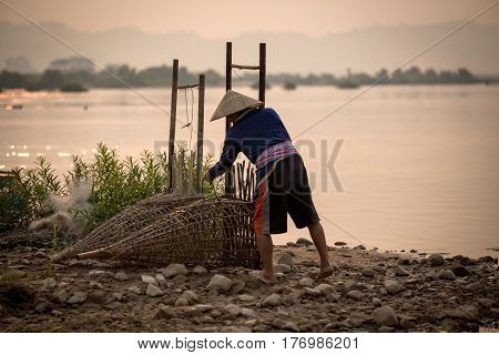 Thai people is fisherman in Mekong river Thailand - Laos Is lifestyle people in Mekong river He is a hope of Fisherman family. A working in sunrise time.