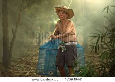 Senior old man is fisherman in Mekong river Thai and Laos.Going to fish in the Mekong River.