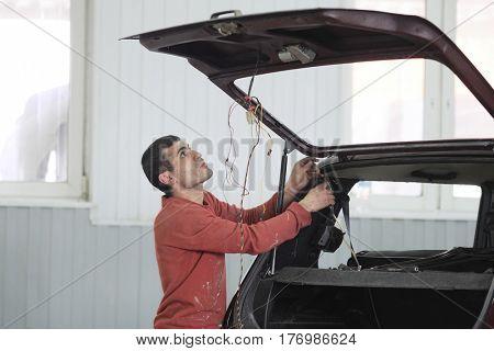 Kaluga, Russia - March, 15, 2017: Car mechanic in a car repair station