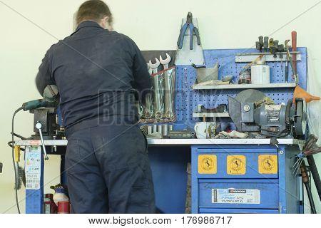 Kaluga, Russia - January, 10, 2017: Car mechanic in a car repair station