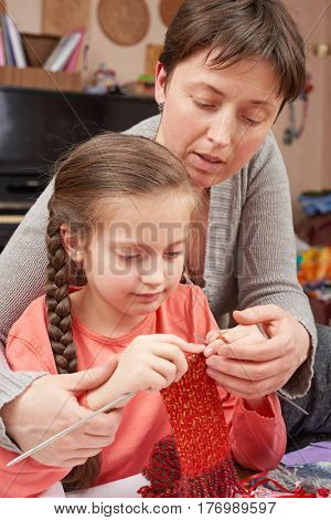 mother teaching daughter girl knit, emotions and difficulties, handmade and handicraft concept