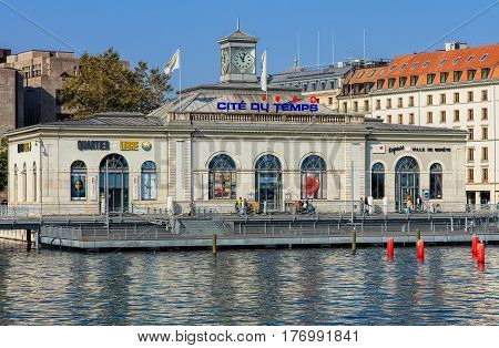 Geneva, Switzerland - 24 September, 2016: the La Cite du Temps building, view from the Pont des Bergues bridge. La Cite du Temps is a public exhibition center focusing on the world of time, hosting a wide variety of different exhibitions.