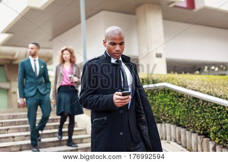 Business people walking through La Defense financial district, Paris, France
