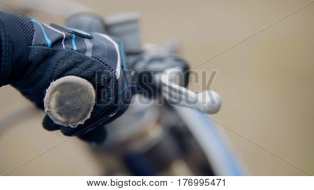 Cross motorcycle engine start. MX, hand on handlebar, close up