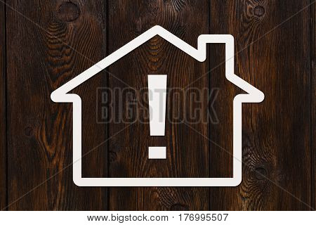 Paper house with exclamation point inside. Abstract conceptual image
