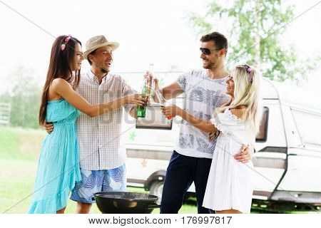 Happy friends having a party outdoors. Holiday, party, free time concept.