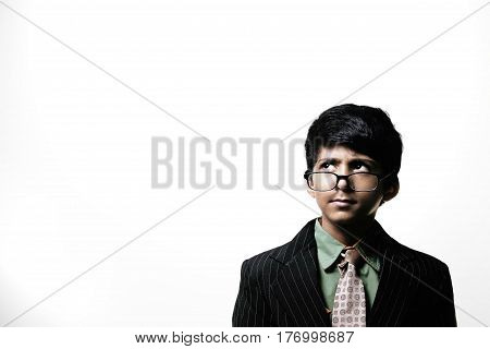 Cute Intelligent Little Boy Wearing Glasses On Nose isolated on white background