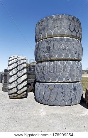 stack of old used bulldozer tire, front view