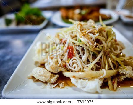 Som Tum with rice noodle in Thai Restaurant