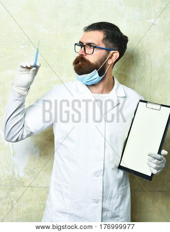 Bearded Brutal Caucasian Doctor Or Postgraduate Student Holding Clipboard
