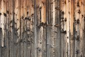 Wood background of old beautifully discolored from time and natural precipitations planks. poster