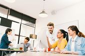 Multiethnic diverse group of people at work. Creative team casual business coworker or college students in strategic meeting or project brainstorm discussion at office. Startup or teamwork concept poster