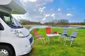 Family vacation, RV (camper) travel concept, motorhome trip, table and chairs in holiday campsite poster