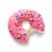 Pink frosted donut with colorful sprinkles with bite missing. Isolated on white background and include clipping path poster