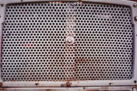 Improvised Radiator Grill Of A Tractor Close Up