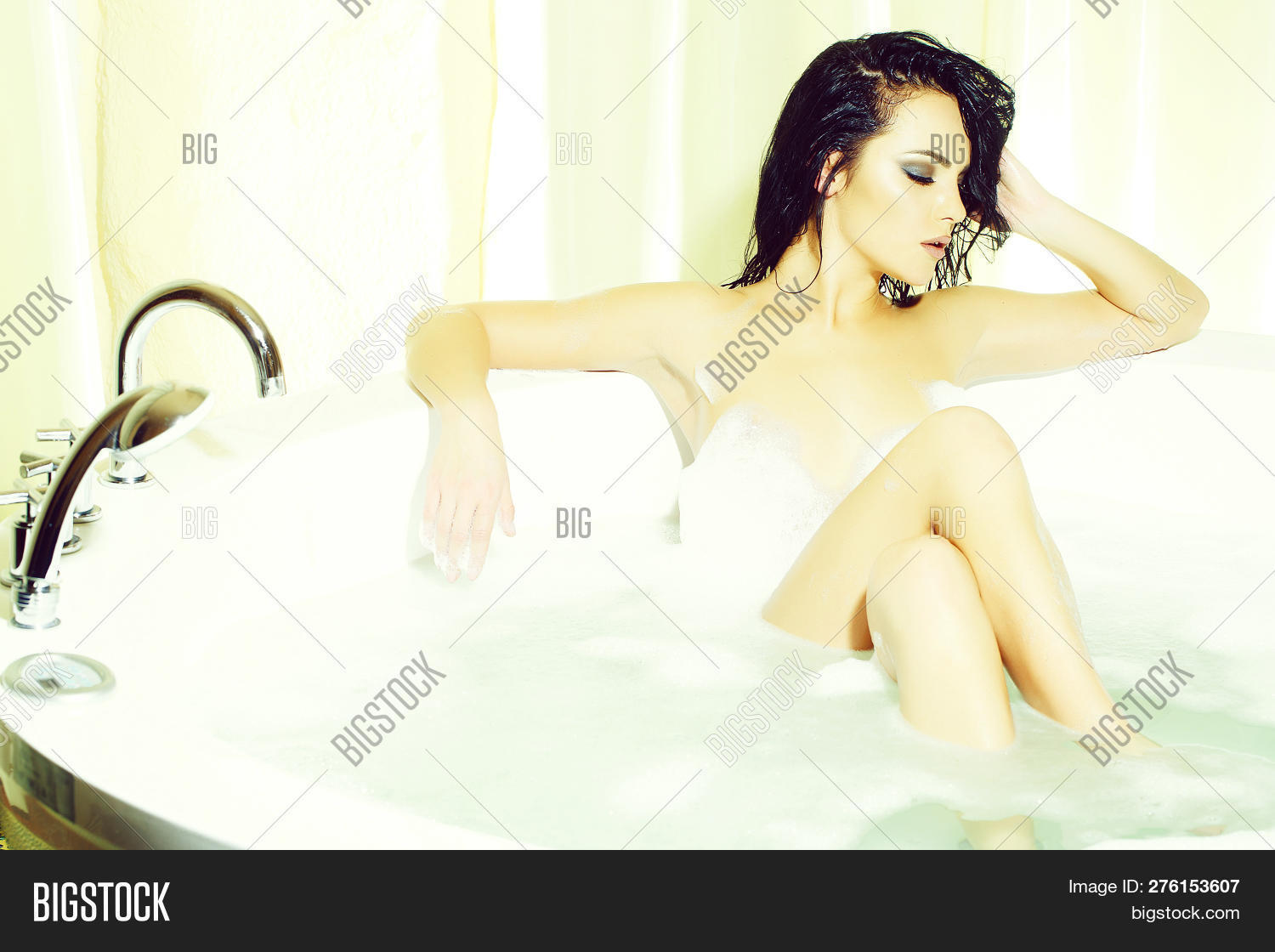 Brunette naked women in the bathtub One Attractive Image Photo Free Trial Bigstock