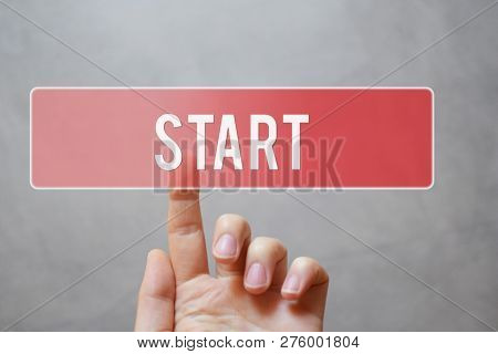 Start - Hand Pressing Red Transparent Button On Virtual Touchscreen Interface On Grey Background Wit
