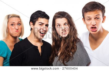 Young group of people grimacing and having fun