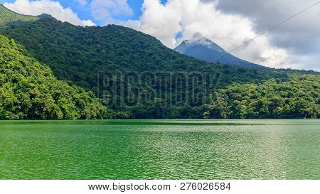 View Of Lake Bulusan In The Mountains With Green Rain Forest. Lake Hidden In The Jungle Mountains Ne