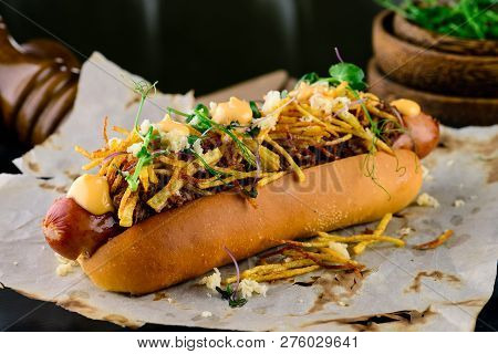 Delicious Grilled Hotdog In A Restaurant, Homemade Bacon Wrapped Hot Dogs With Onions And Peppers