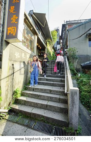 Jiufen, Taiwan - November 21, 2018: Tourist Step Up The Stairs To Jiufen Village. This Place Is A Tr
