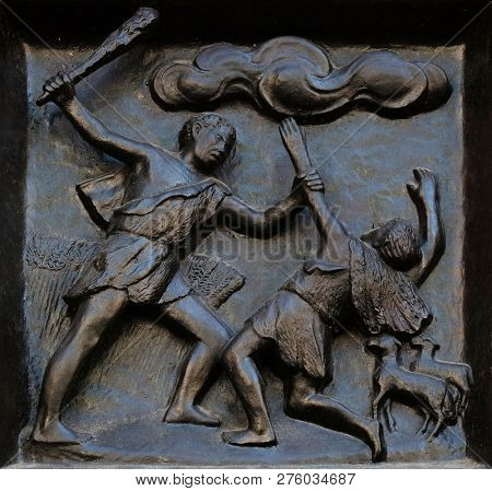 ZURICH, SWITZERLAND - JUNE 23, 2018: Thou shalt not kill - Cain and Abel, relief on the door of the Grossmunster (