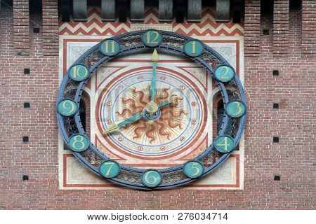 MILAN, ITALY - JUNE 22, 2018: Clock on the Sforza Castle in Milano, Italy, built in the 15th century by Francesco Sforza, Duke of Milan, on the remnants of a 14th-century fortification