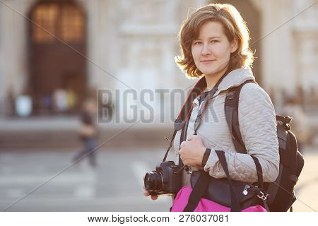 Photography On A Journey. A Young Woman Takes Pictures On A Trip. Portrait Of The Photographer In Th