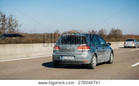 Frankfurt, Germany - Dec 25, 2018: Rear View Of Blue Dirty Volkswagen Golf Car Driving Fast On Germa