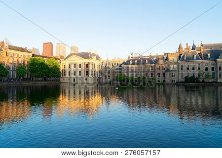 Mauritshuis And Binnenhof Reflecting In Pond At Spring, Netherlands