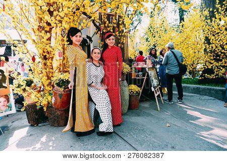 Ho Chi Minh, Vietnam 01-2018: Vietnamese Lunar New Year. Women Wear Vietnam Tradition Ao Dai To Take