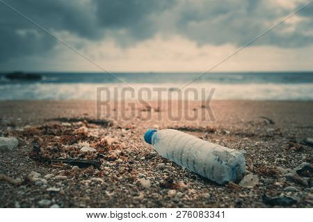 Trash, Plastic, Garbage, Bottle... Environmental Pollution On The Beach. Royalty High-quality Free S