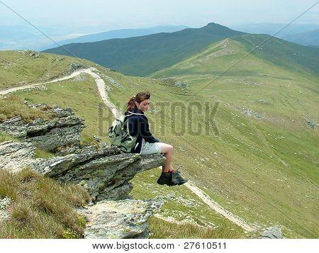 Mountaineer girl on the rock