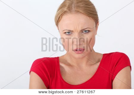 Woman in red shirt with angry look