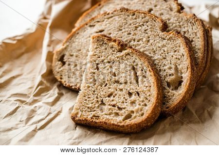 Artisan Sliced Homemade Sourdough Bread Slices with Paper Bag / Package or Craft Paper. Organic Bakery Food. poster