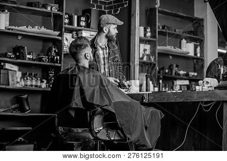 Hipster Client Got New Haircut. Barber Finished Trimming. Barber With Bearded Man Looking At Mirror,