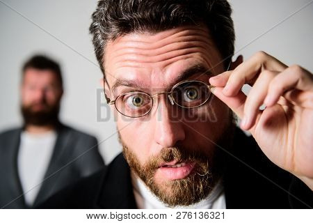 Picky smart inspector. Man handsome bearded guy wear eyeglasses. Eye health and sight. Optics and vision concept. Smart glance. Accessory for smart appearance. Attentive glance. Now i see everything. poster