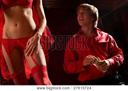 View of man offering money to a stripper on stage poster