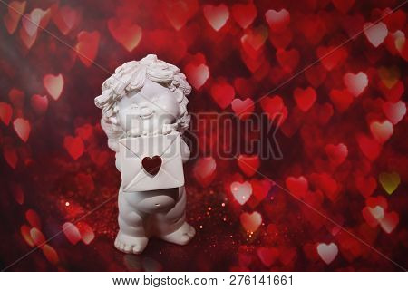 Cherub Baby Angel With Heart And Bokeh. St Valentine Card, Love And Sentiment Concept