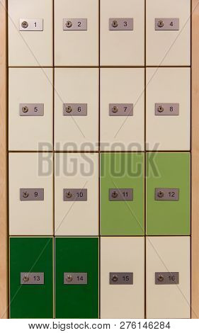 Cabinet Post Box, Close-up Of Rows Of Green And White Mailboxes Outside Of Post Office. Wall Of Wood