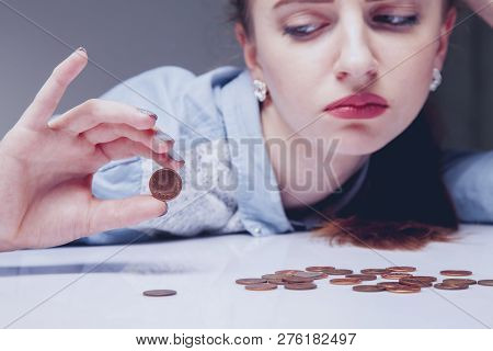 Family Debts. Young Frustrated And Desperate Woman Counting Small Money As Symbol Of Bankrupt And Po