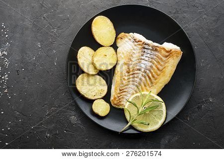 Cod Fillet Baked With Fresh Farmers Vegetables: Potatoes, Carrots, Onions. Top View